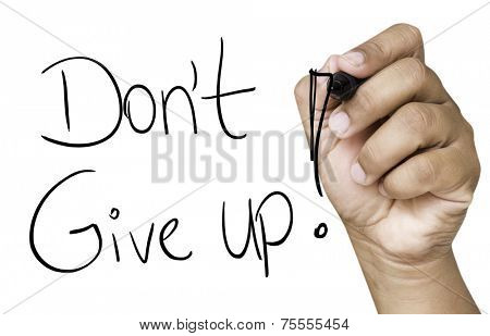 Don't Give Up hand writing with black marker on transparent wipe board