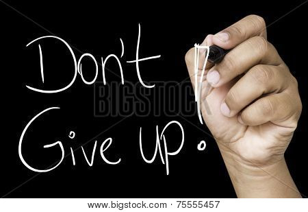 Don't Give Up hand writing with white marker on transparent wipe board