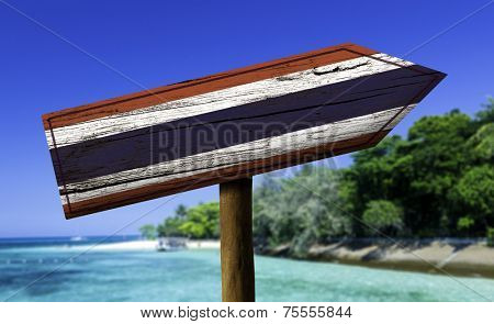 Thailand wooden sign with a beach on background - Asia