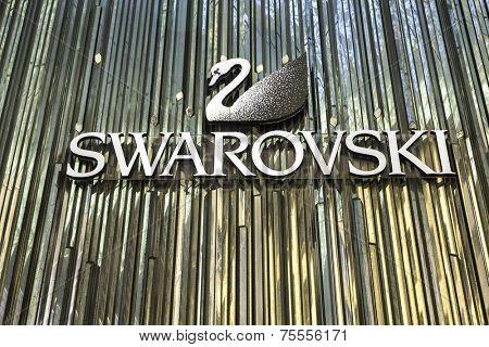 SYDNEY, AUSTRALIA - JANUARY 4: Swarovski logo on January 4, 2014 in Sydney, Australia. Swarovski is an Austrian producer of luxury cut lead glass (crystal).