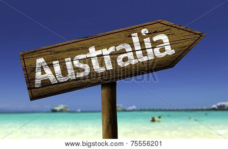 Australia wooden sign with a beach on background - Oceania
