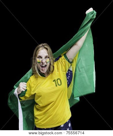 Woman holds a flag of brazil isolated on black background