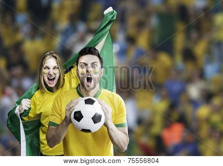 Brazilian couple celebrate on the stadium
