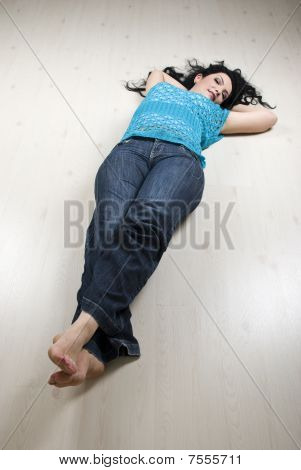 Lying Woman On White Laminate Flooring