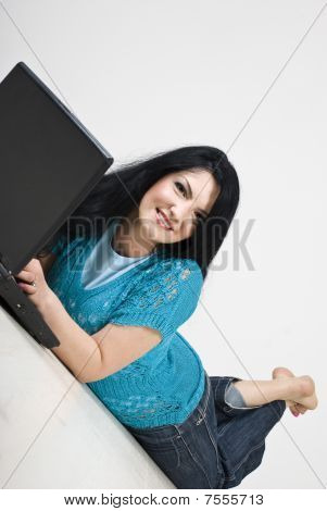Woman Relaxing And Browsing Internet
