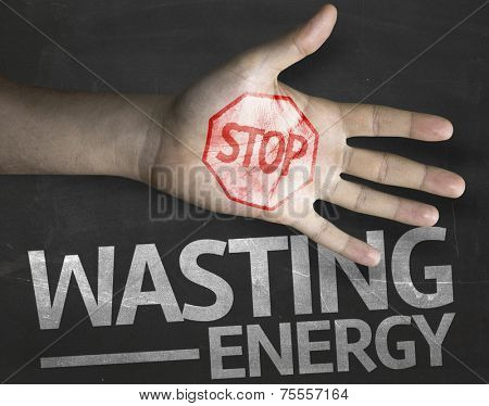 Educational and Creative composition with the message Stop Wasting Energy on the blackboard