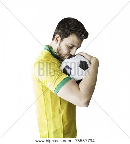 Brazilian man celebrates kissing a soccer ball on a white background