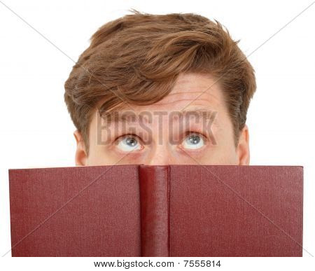 Man Dreamily Reading Book - Close-up Of Eyes
