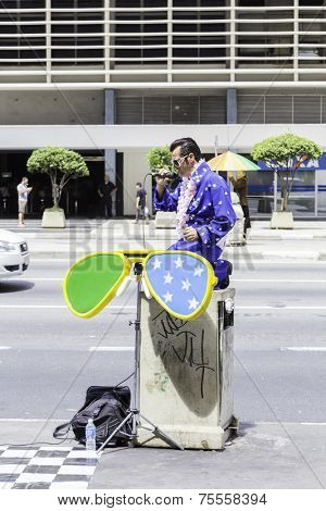 SAO PAULO, BRAZIL - CIRCA JAN 14 - Elvis Presley cover performes on Paulista Avenue in Sao Paulo, Brazil.