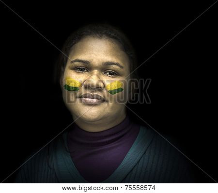 Portrait of a Brazilian with yellow and green painted on her face
