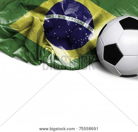 Waving flag of Brazil and a soccer ball
