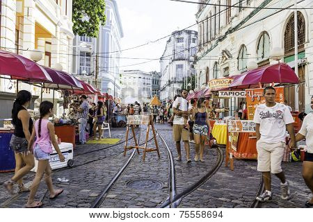 RECIFE, BRAZIL - CIRCA JANUARY 2014: People enjoy a local market on the street in the downtown of Recife, Pernambuco