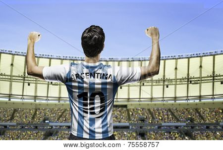 Argentinian soccer player celebrates on the stadium with the fans