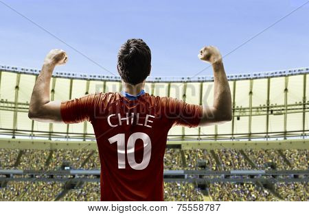 Chilean soccer player celebrates on the stadium