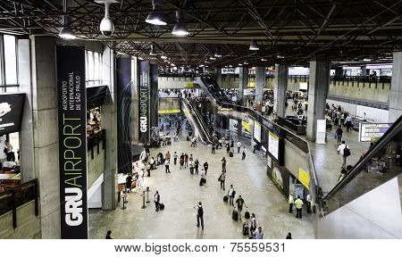 SAO PAULO, BRAZIL - CIRCA JANUARY 2014: Passengers walk through Guarulhos Airport in Sao Paulo, Brazil. Guarulhos is the main airport serving Sao Paulo, Brazil.