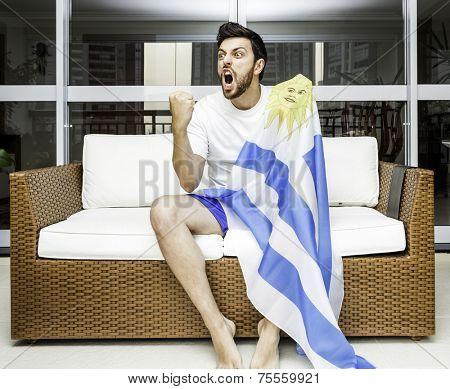 Uruguayan fan celebrates at home