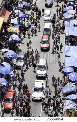 SAO PAULO, BRAZIL - CIRCA MARCH 2014: Hundreds of People walk along the 25 March area in Sao Paulo, Brazil. 25 March is a popular commerce region near the center of Sao Paulo, Brazil.