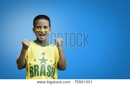 Brazilian fan boy celebrates on blue background