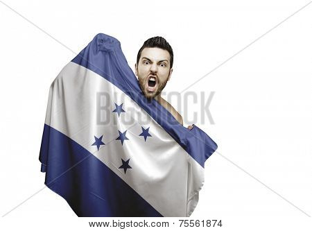 Fan holding the flag of Honduras celebrates on white background