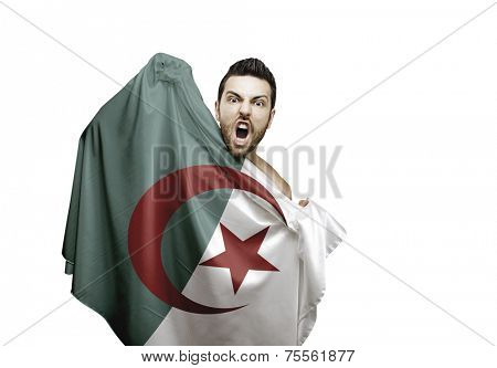 Fan holding the flag of Algeria celebrates on white background
