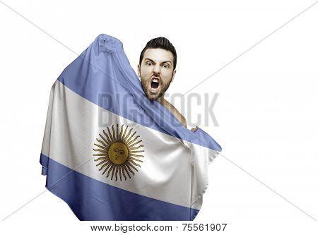 Fan holding the flag of Argentina celebrates on white background