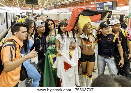 SAO PAULO, BRAZIL - JUNE 12, 2014: Beautiful girls go to Arena Sao Paulo for the first game of the the Brazilian World Cup 2014 (Brazil x Croatia).