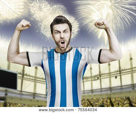 Argentinian soccer player celebrates on the stadium