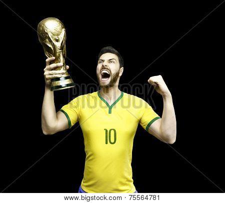 Brazilian soccer player celebrates the championship holding a trophy on black background