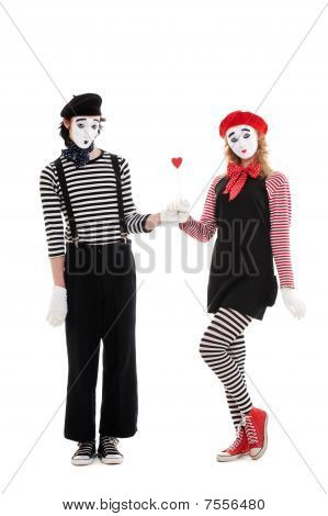 Man Giving Small Red Heart To Young Woman