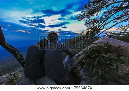 Yong Couple Looking At Sunset