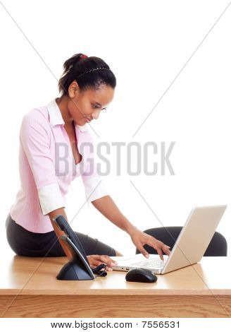 Student Sitting On The Table And Typing
