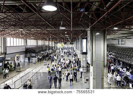 SAO PAULO, BRAZIL - CIRCA MARCH 2014: Passengers walk through Guarulhos Airport in Sao Paulo, Brazil. Guarulhos is the main airport serving Sao Paulo, Brazil.