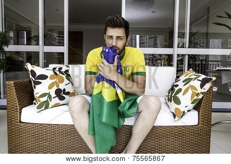 Brazilian supporter gets nervous during the match