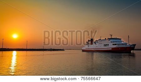 view of passenger ferry boat in open waters in Greece at sunrise