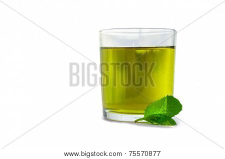 Mint Tea In A Glass With Mint Leaves Next To It On A White Background