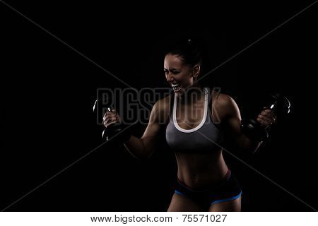 Young Sports-looking Nice Lady With Dark Hair lifting weights