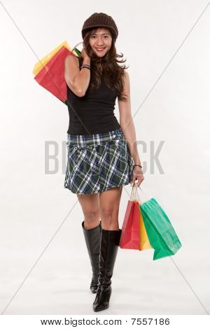 Attractive Thirties Asian Woman Shopping
