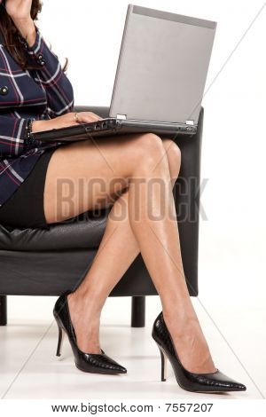Businesswoman Legs With Laptop