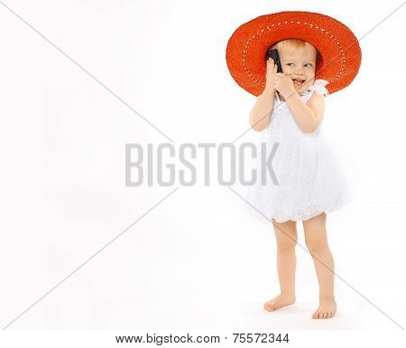 Little Cheerful Girl Child In A Red Hat And White Dress Speaks On The Phone, Vacation, Travel, Summe