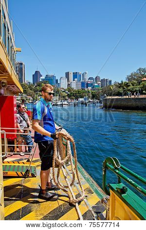 Deckhand throws the mooring rope