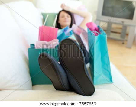 Brunette Woman Relaxing After Shopping