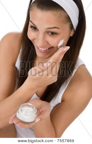Beauty Facial Care - Young Woman Apply Moisturizer