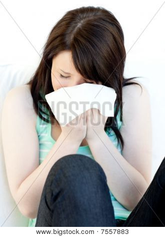 Portrait Of A Sick Caucasian Woman Blowing