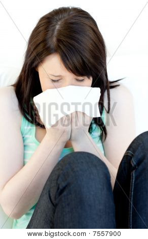 Portrait Of A Sick Brunette Woman Blowing