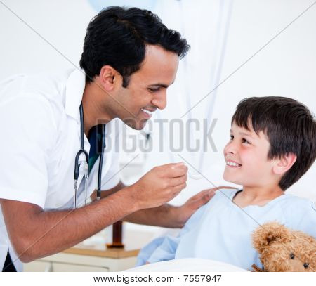 Smiling Sick Little Boy Taking Medicine