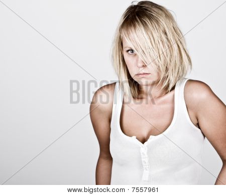 Pensive Blonde Female In White Vest