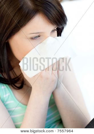 Portrait Of A Sick Brunette Teen Girl Blowing