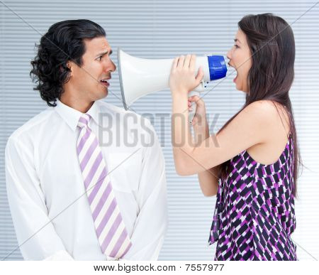 Furious Businesswoman Yelling Through A Megaphone