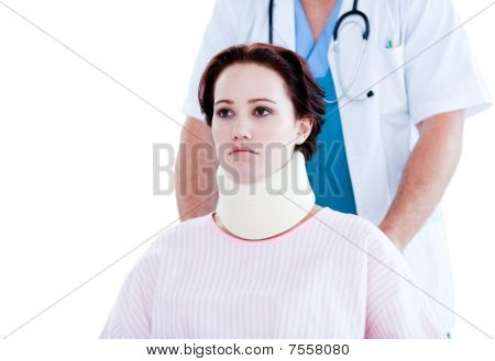 Portrait Of An Upset Woman With A Neck Brace Sitting On A Wheelchair