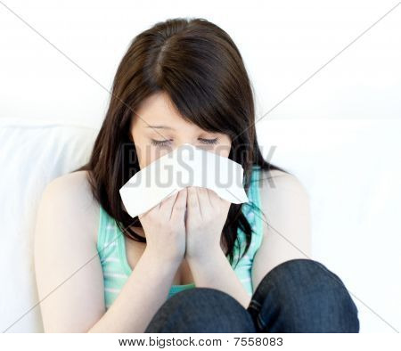 Sick Teen Girl Blowing Sitting On A Sofa